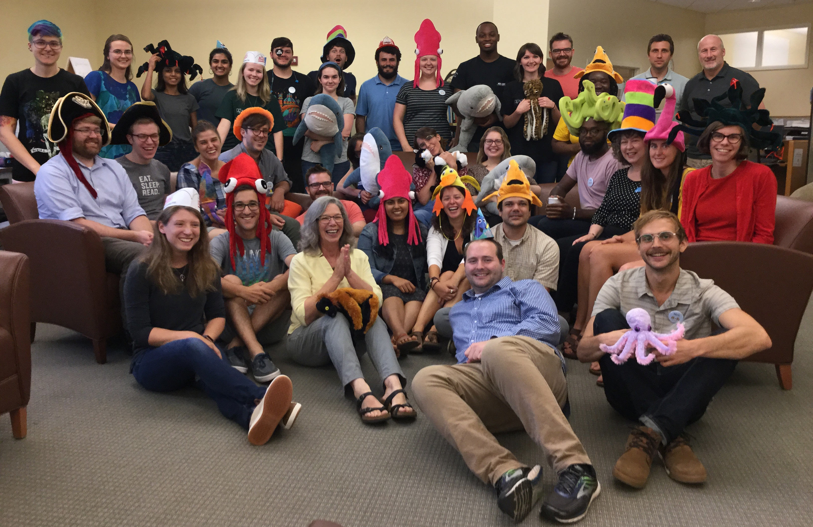 staff assembled and wearing funny hats