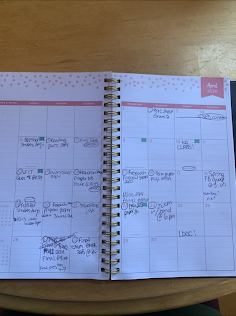 A photo of a planner open to show calendar days with activities and tasks filled in.