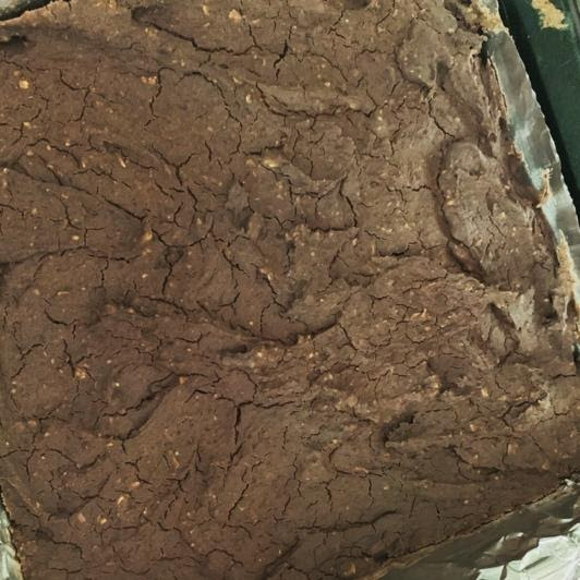 A photo of a brownie pan featuring black bean brownies before being cut.