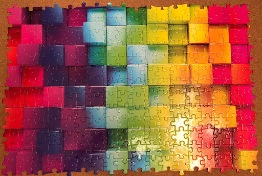 A multi-colored, abstract puzzle lacks border pieces on all four sides.