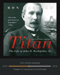 The author listens to the audiobook Titan: The life of John D. Rockefeller, Sr. by Ron Chernow as another example of a reward.