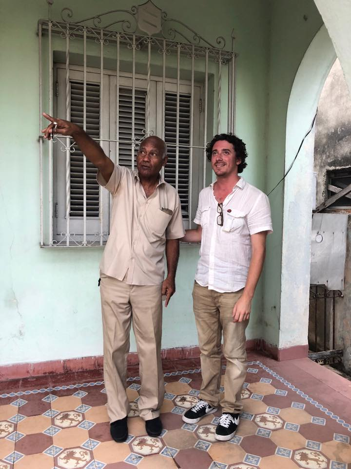 Jorge and Tony stand on colored tiles in Havana