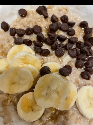Oatmeal topped with sliced bananas and chocolate chips.
