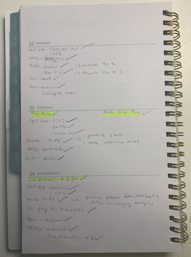 A checklist written in a notebook with multiple items checked off.